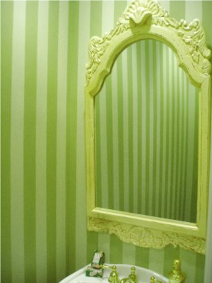 Green faux stripes in a powder room.