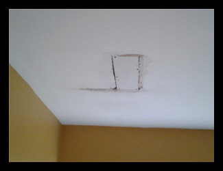 Replacing some drywall in a ceiling.